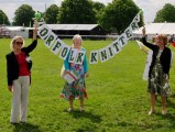 Jennifer and Rosemary proudly hold the Norfolk Knitters banner
